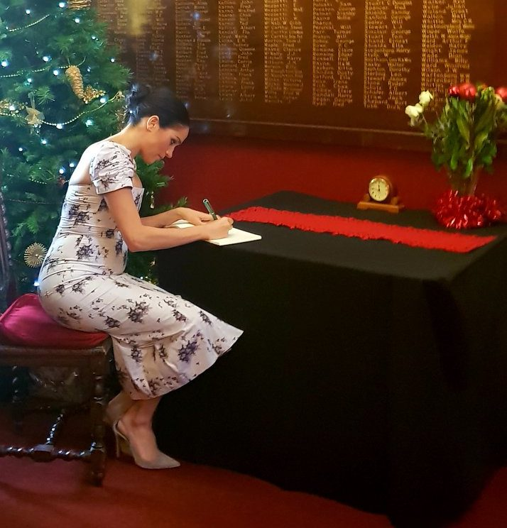 081cd6bba0 Duchess of Sussex in festive florals at Royal Variety care home